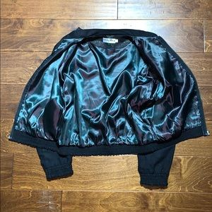 Vintage black leather jacket with silk lining
